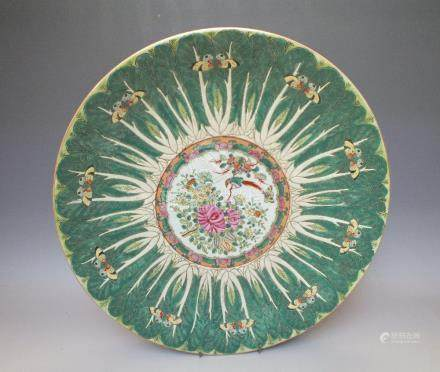 A CHINESE FAMILLE ROSE LARGE CIRCULAR CHARGER, decorated with butterflies on a pak choi ground and a