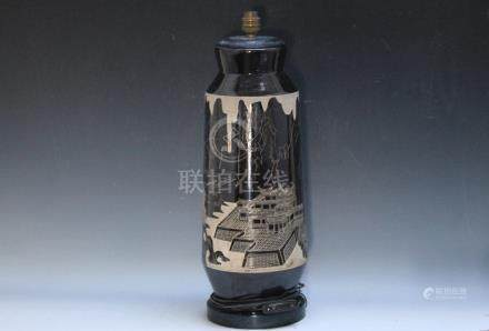 A TALL ORIENTAL STYLE LAMP, decorated with a mountainous temple style scene, H 55 cm including