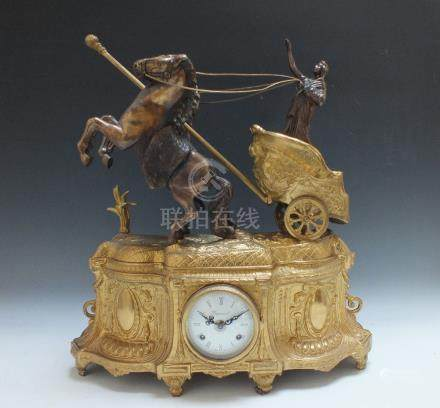 AM IMPRESSIVE BRASS FIGURAL MANTLE CLOCK, in the form of Boudica on a chariot with two rearing