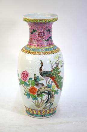 A famille rose vase with trumpet neck and oviform body, decorated with a peacock and peahen in a