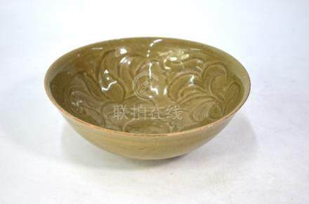 A Northern Song style Celadon bowl, decorated with bold floral designs in the interior, 18 cm