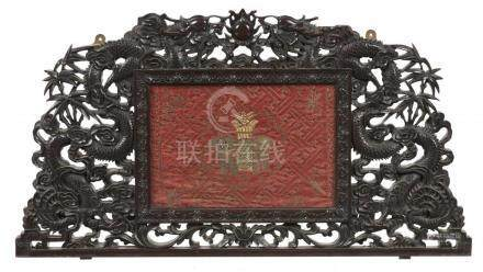 A CHINESE HONGMU FRAME, LATE 19TH C profusely carved with dragons and clouds, retaining an