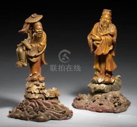 A PAIR OF CHINESE SOAPSTONE STATUETTES OF IMMORTALS, QING DYNASTY, 19TH C standing on pierced