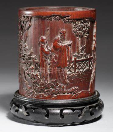 A CHINESE CARVED BAMBOO POT WITH AN IMMORTAL AND ATTENDANT 11cm h, wood stand++Good condition