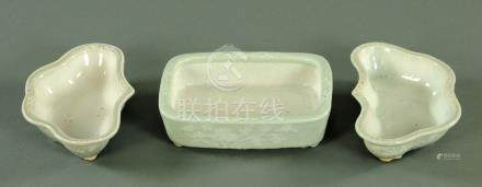A pair of Chinese celadon shaped dishes, and a matching rectangular dish,