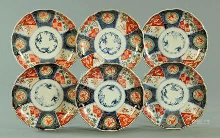 A set of six Japanese Imari dished and scalloped plates, circa 1880,