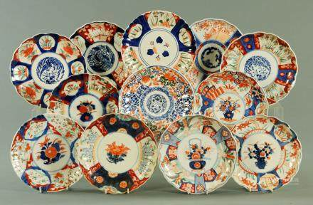 Twelve Japanese Imari dishes, each of scalloped form and decorated in typical Imari colours,