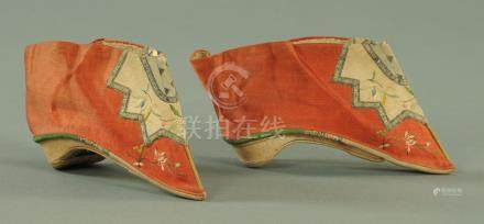 A pair of Chinese silk and embroidered child's shoes, early 20th century,