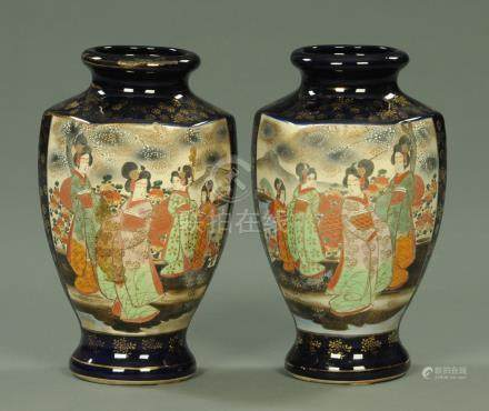 A pair of Japanese vases, decorated with panels of figures and with gold seal mark to base.