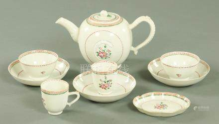A Chinese porcelain teapot with matching cups, tea bowls, saucers and spoon rest, circa 1790,