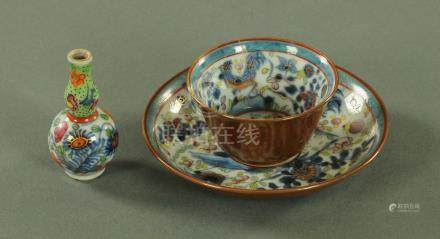 """A Chinese porcelain """"Batavian"""" blue and white tea bowl and saucer, European decorated,"""