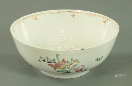 A Chinese porcelain bowl, circa 1770, decorated with polychrome floral sprays to the exterior,