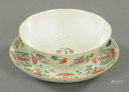 A Famille Rose Luck and Longevity dished plate, early 19th century,