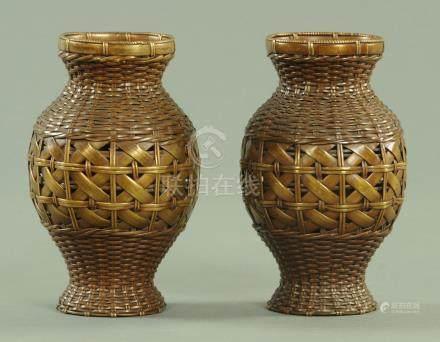 A pair of Japanese woven bronze basket vases, circa 1900, 16.3 cm high.