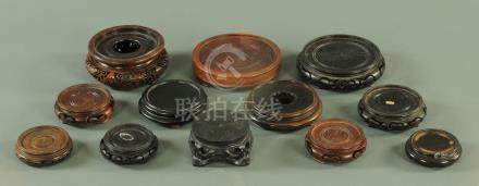 A collection of Chinese carved and turned black wood vase stands, late 19th century and later,
