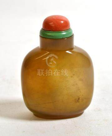A Chinese Agate Snuff Bottle, 19th century, of flattened ovoid form, 7.8cm high