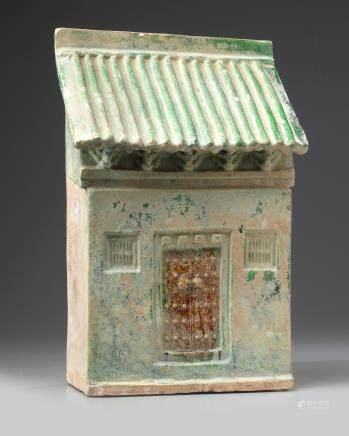 A Chinese green-glazed pottery store house