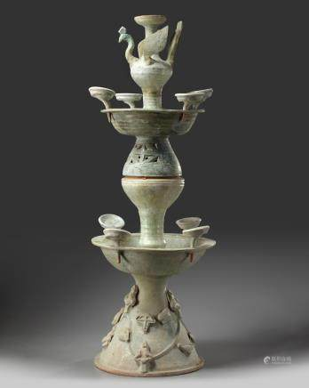 A Chinese green-glazed pottery two-tiered oil lamp