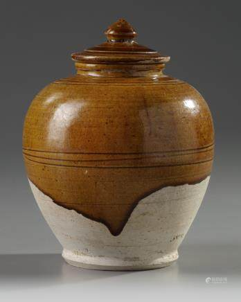 A Chinese amber-glazed jar and cover
