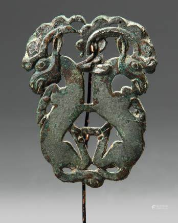 An Ordos bronze 'twin-ibex' fitting