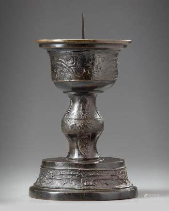 A Chinese bronze candle holder
