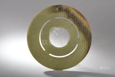 Disque Bi, symbole du ciel composé d'un double cercle concentrique à décor arch