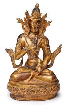 Buddha, Tibet wohl um 1910.Bronze, vergoldet. Lotossitz, in d. Händen vor d. Körper 2 Gegenstände,