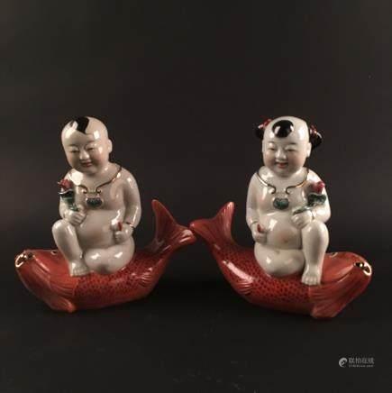 A Pair of Chinese Porcelain 'Li Yu Tong Zi'  Figure