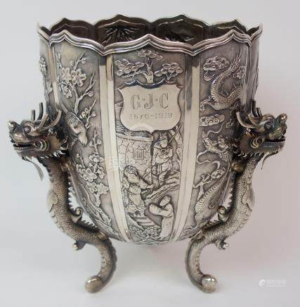 A CHINESE SILVER PRESENTATION LOBED VASE decorated with panels of figures, dragons, birds and