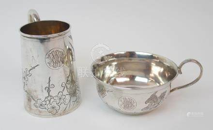 A CHINESE SILVER TANKARD engraved with a bird amongst blossom beside a circular monogrammed