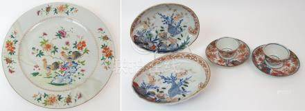 A CHINESE FAMILLE ROSE CHARGER painted with cockerels amongst foliage and blue rockwork within a