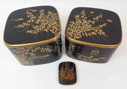 TWO BLACK AND GOLD LACQUERED TWO-SECTION BOXES decorated with birds amongst foliage (cracks and