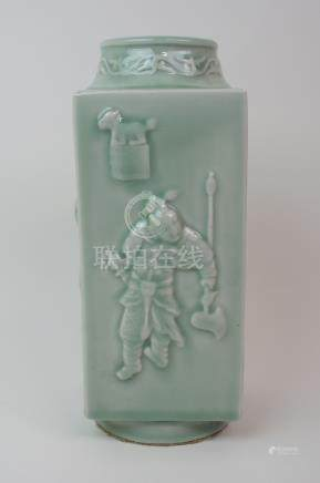 A CHINESE CELADON CONG VASE moulded with figures and symbols with foliate neck and ring foot,