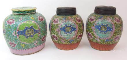 THREE CANTON JARS painted with shou medallions amongst foliage on a yellow ground above a stiff leaf