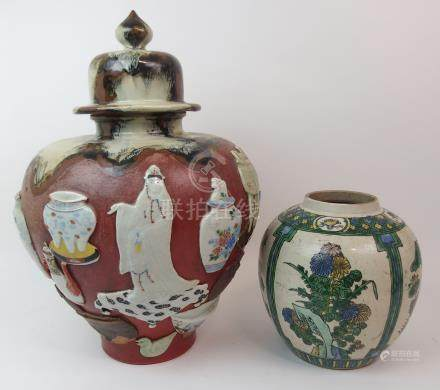 A SUMIDA WARE BALUSTER VASE AND DOMED COVER applied in high relief with Kannon, devotee and precious