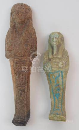AN EGYPTIAN SHABTI DOLL moulded with hieroglyphs (repaired), 17cm high and another, 13cm high (2)