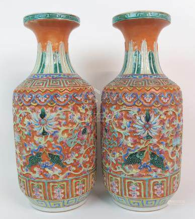 A PAIR OF CANTON RELIEF MOULDED BALUSTER VASES decorated with precious symbols within key pattern