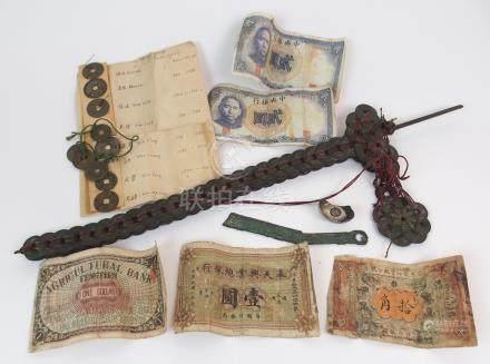 NUMISMATIC INTEREST; A silver ingot 34.8 grams, 3cm wide, dagger made of cash coins, 41cm long,