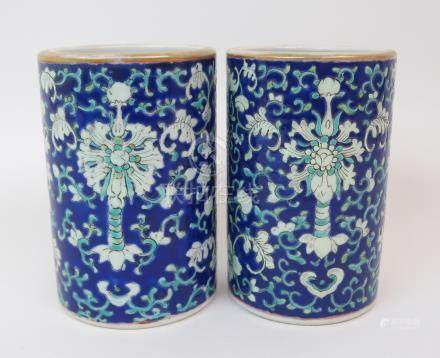 A PAIR OF CANTON BRUSH WASHER VASES painted with bats, peonies and brocade on a blue ground, gilt