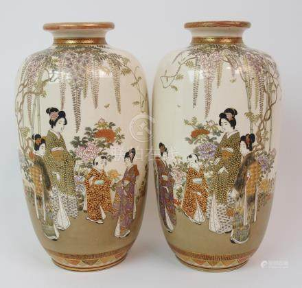 A PAIR OF SATSUMA VASES painted with ladies and children beneath wisteria and amongst flowers,
