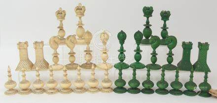 AN EAST INDIAN IVORY CHEST SET probably Berhampore, one set stained green, lacking one pawn, (with