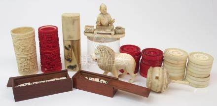 A SET OF THIRTY CARVED DRAUGHTS 3cm diameter, two Chinese dice tumblers, 6.5cm high, lion 5m high,