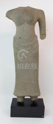 AN ASIAN STONE CARVING OF A FEMALE TORSO bare chested and wearing a ribbon tied patterned dress, (