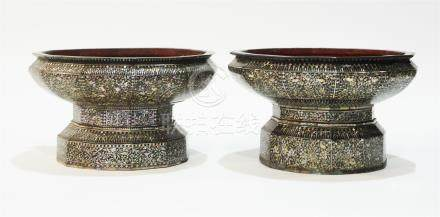 Near pair of Thai offering bowls.