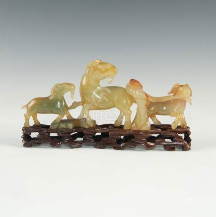 CHINESE CARVED HARD STONE GROUP THREE RAMS, WOODEN BASE