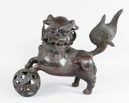 Male Fo lion, Bronze cast with original brown patina, with open work cast bronze bowl decorated with