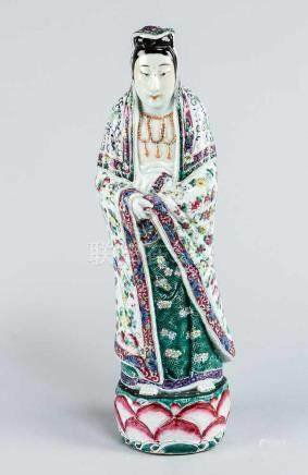 Chinese Porcelain Figure, of a standing honourable lady, in traditional dress, on round lotus