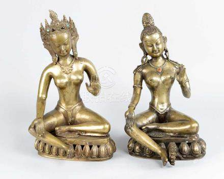 Two Asian Goddesses, in sitting position, and leaning to the right, on open work bases with earth