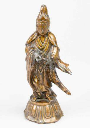 Guanyin, bronze cast with remains of old gilded parts missing damages in standing position on