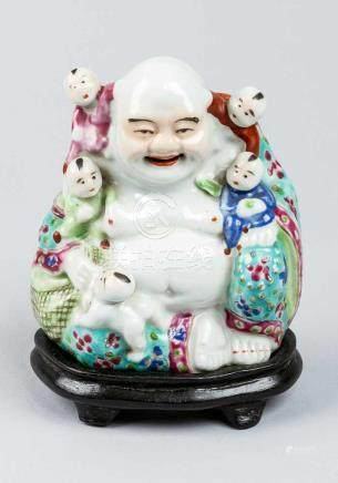 Lucky Budha, porcelain painted and glazed with children on ebonized wooden base Qing Dynasty15 cm